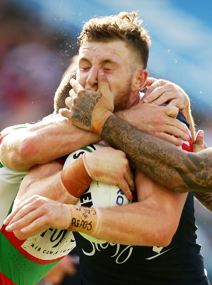 Jackson Hastings of the Sydney Roosters is tackled during the round one NRL match against the South Sydney Rabbitohs in Sydney, Australia.