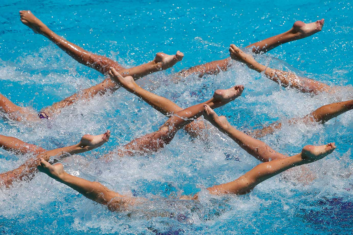 Ukraine's team performs their Free Routine during the Synchronized Swimming Olympic Games Qualification Tournament in Rio de Janeiro, Brazil.