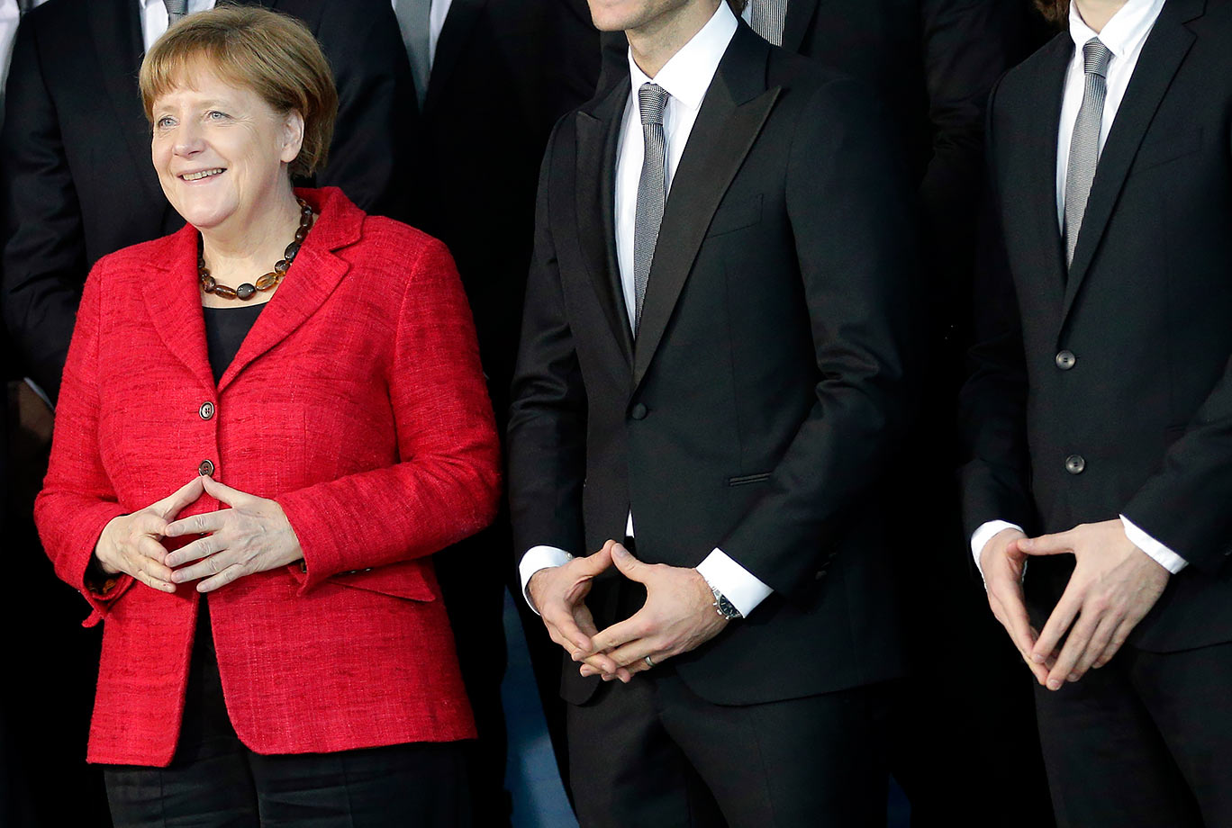 German Chancellor Angela Merkel poses with the National Handball team at the chancellery in Berlin, Germany.