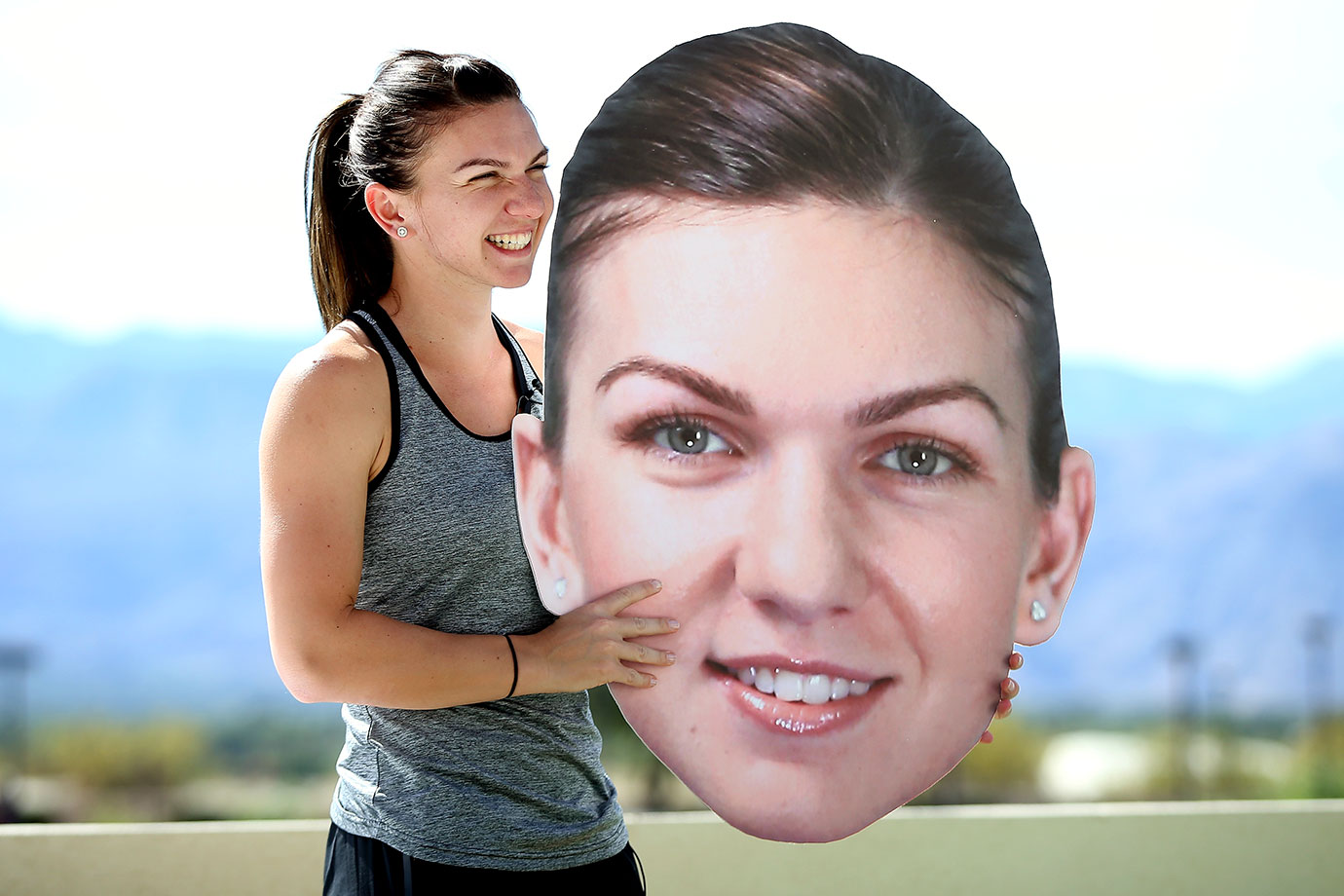 Simona Halep of Romania holds an oversize likeness of her face at the WTA All-Access Hour during the BNP Paribas Open in Indian Wells, Calif.