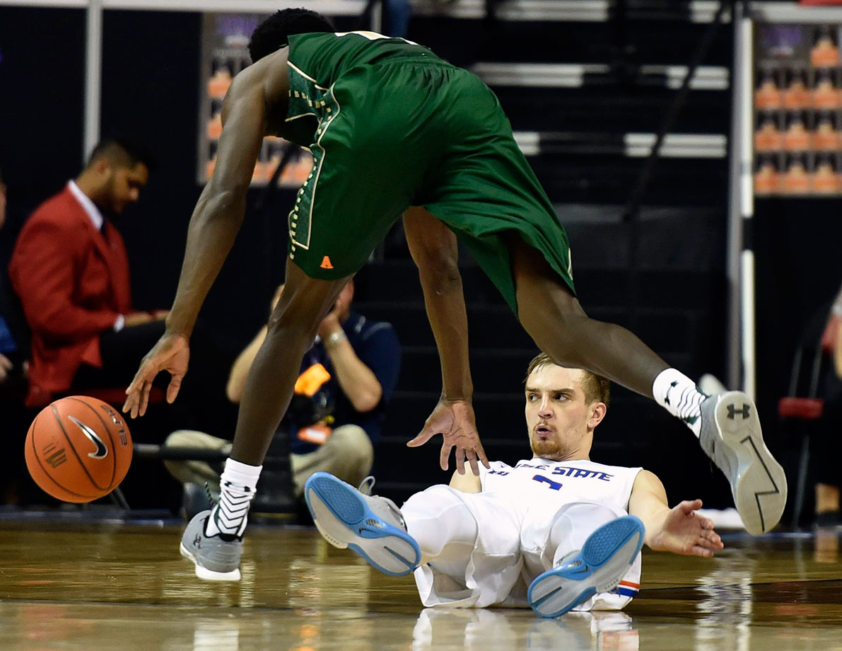 Boise State guard Anthony Drmic lies on the court after being called for blocking on Colorado State guard Joe De Ciman during the second half of their Mountain West Conference Tournament game in Las Vegas.