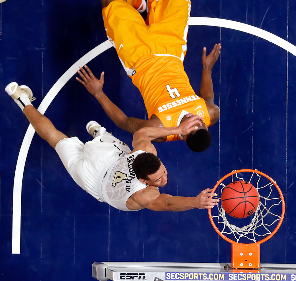 Vanderbilt guard Wade Baldwin IV dunks over Tennessee forward Armani Moore during the second half of their SEC Tournament game in Nashville.