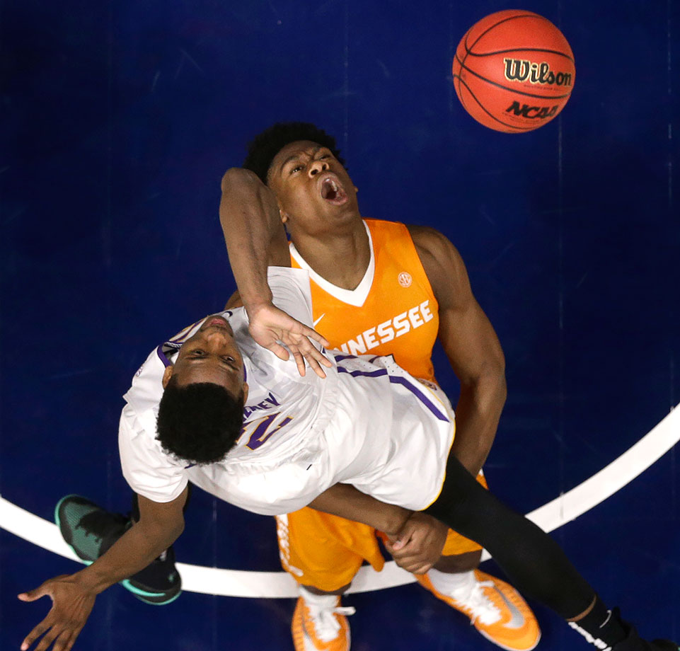Tennessee forward Admiral Schofield falls as LSU guard Antonio Blakeney shoots during the second half of their SEC Tournament game in Nashville.