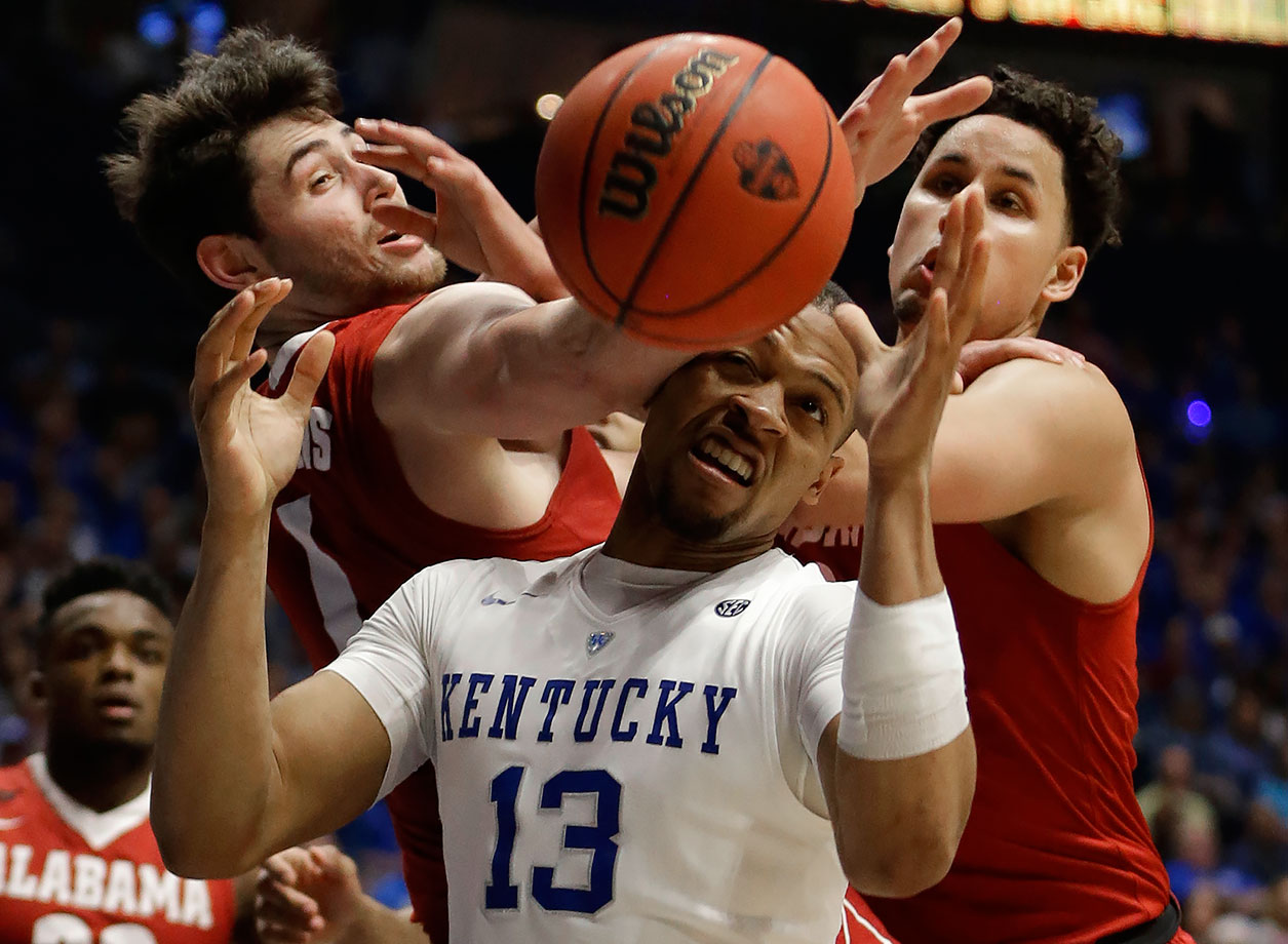 Kentucky guard Isaiah Briscoe battles for a rebound against Alabama forwards Riley Norris and Michael Kessens during the first half of their SEC Tournament game against Georgia in Nashville.