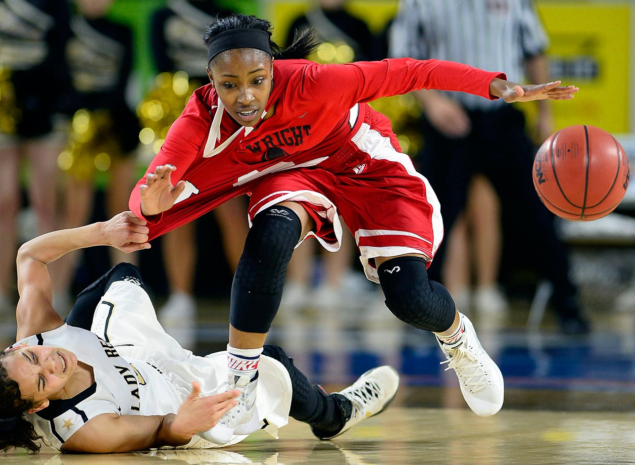 Upperman guard Akira Levy pulls East Nashville guard Erica Haynes-Overton as they chase the ball during the second half of the Tennessee Division I AA girls high school basketball championship game in Murfreesboro, Tenn.