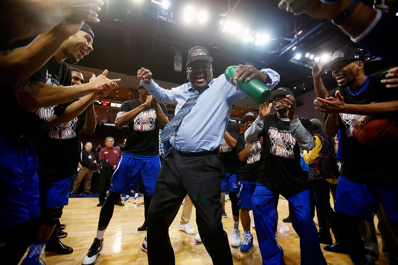 Cal State Bakersfield coach Rod Barnes dances while surrounded by his team following their WAC Tournament victory over New Mexico State in Las Vegas.