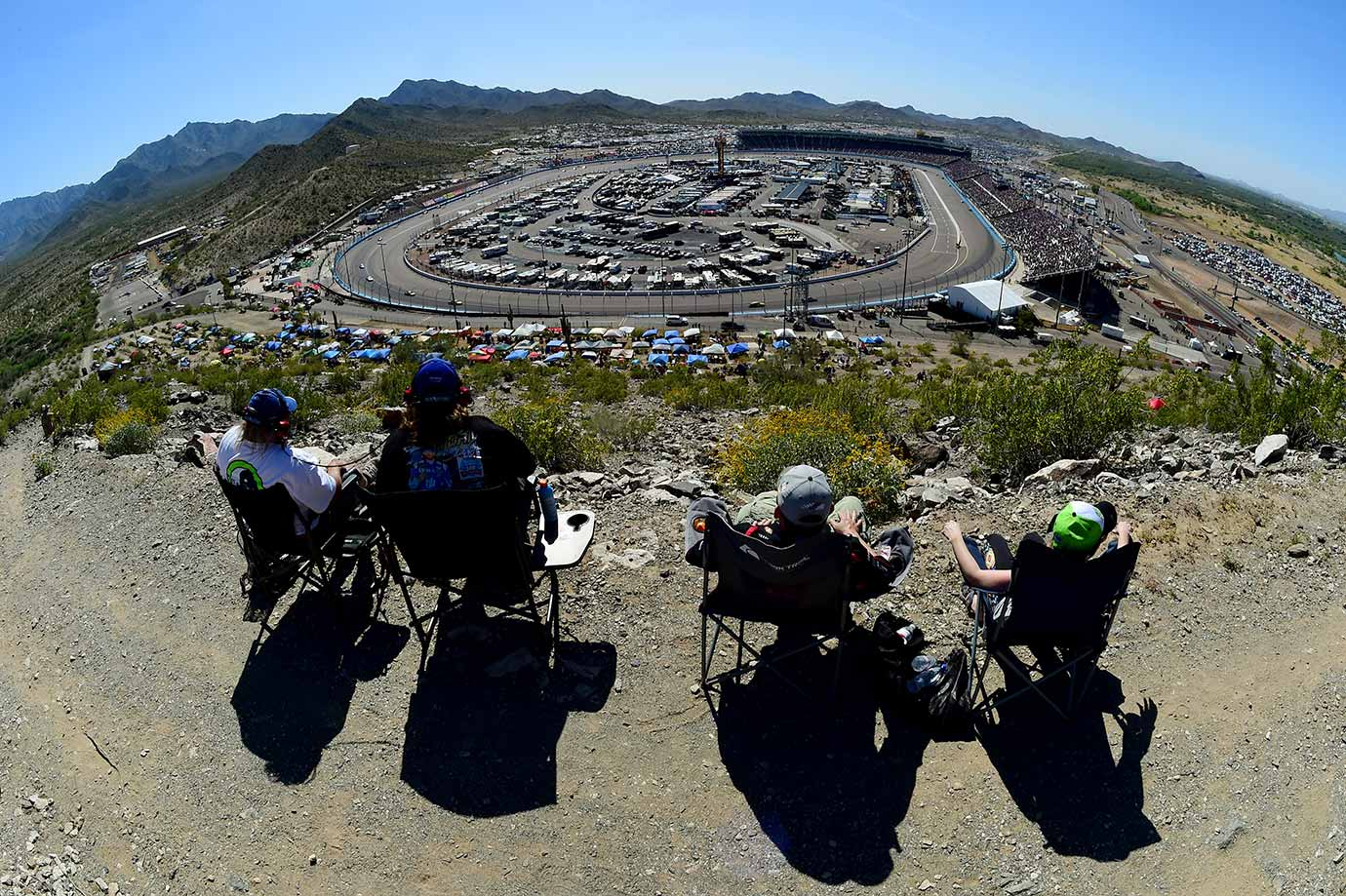 Race fans enjoy the action during the NASCAR Sprint Cup Series Good Sam 500 at Phoenix International Raceway in Avondale, Ariz.