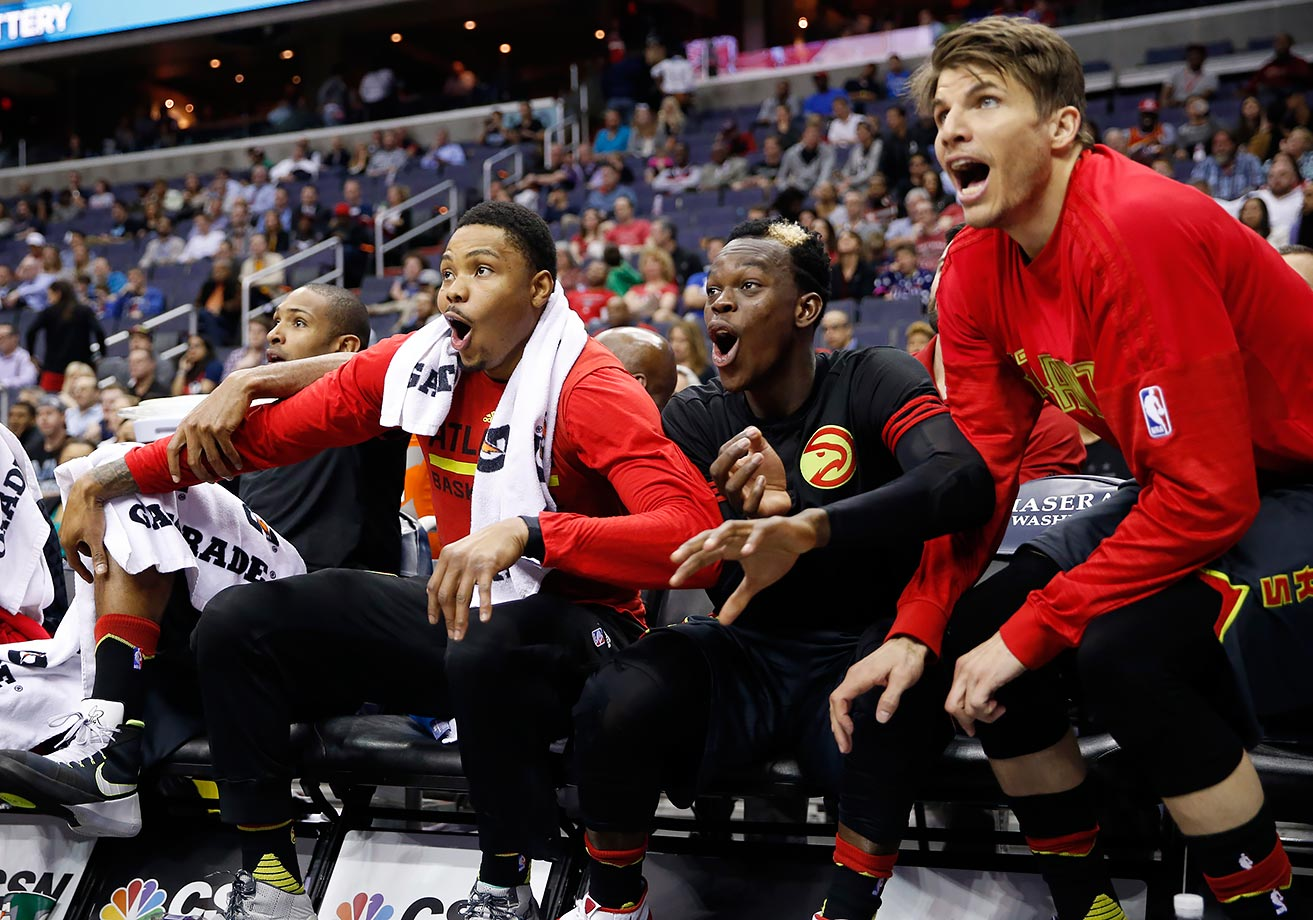 Atlanta Hawks forward Kent Bazemore, guard Dennis Schroeder and guard Kyle Korver celebrate a play during the second half their game against the Washington Wizards in Washington, D.C.