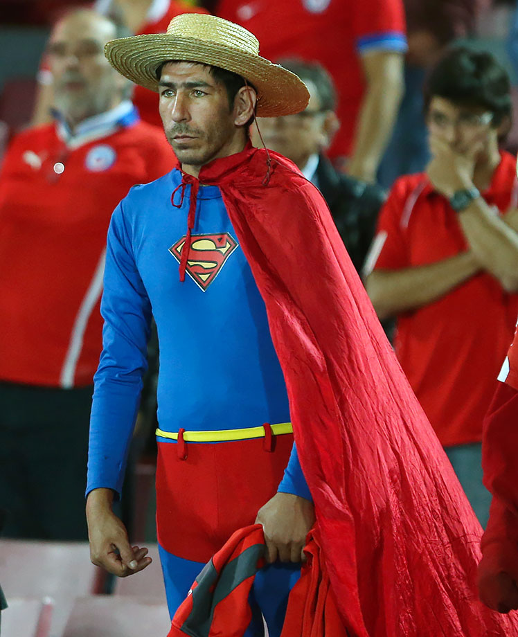 A fan of Chile's soccer team dressed as Superman watches his team's 2-1 loss to Argentina during their 2018 FIFA World Cup Russia Qualifiers match in Santiago, Chile.