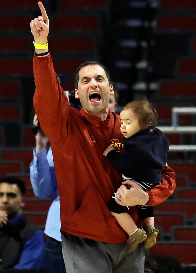 Iowa State coach Steve Prohm yells during his team's practice as he holds his son Cass in Chicago.