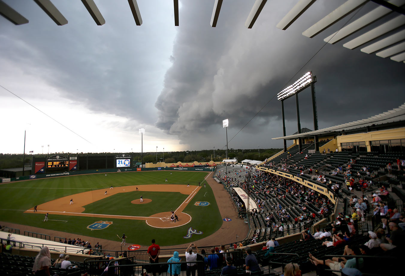 Storm clouds roll in over Champion Stadium during the seventh inning of a spring training game between the Atlanta Braves and the Houston Astrosin Kissimmee, Fla.