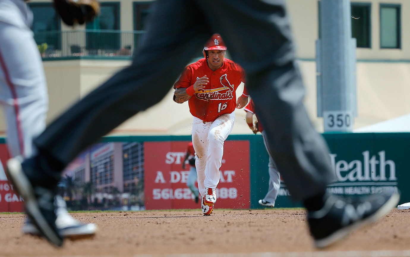 St. Louis Cardinals second baseman Kolten Wong heads for third base during the first inning of a spring training game against the Washington Nationals in Jupiter, Fla.