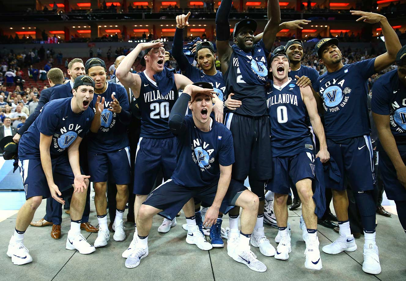 Villanova players celebrate after defeating Kansas 64-59 in Louisville, Ky.
