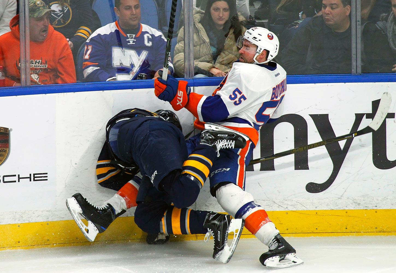 Buffalo Sabres center Jack Eichel and New York Islanders defenseman Johnny Boychuk collide along the boards on Dec. 16, 2016 at KeyBank Center in Buffalo.