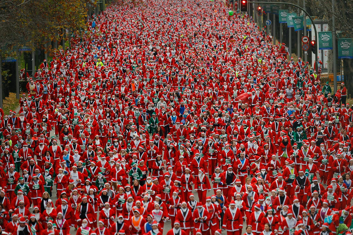Hundreds of people dressed as Santa Claus take part in the Santa Claus run on Dec. 17, 2016 in Madrid, Spain. More than 20,000 participants dressed as Santa Claus participate in the 8k race through the streets of Madrid.