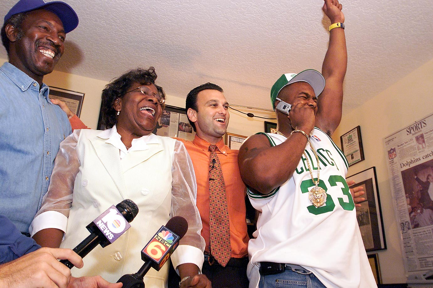 Miami defensive end Jerome McDougle celebrates with his parents and agent after he was taken by the Philadelphia Eagles with the 15th pick in the 2003 NFL draft.