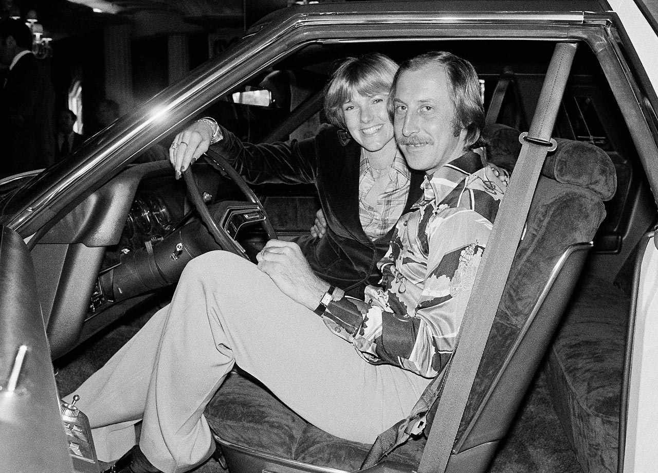 Fred Biletnikoff and his wife, Jennifer, in a car that was presented to him for being the MVP of the Super Bowl in 1977. He had four receptions for 79 yards in the game, as his Raiders defeated the Vikings 32-14.