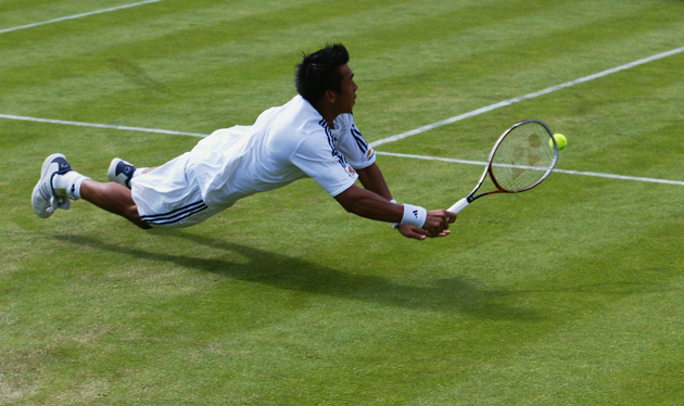 Srichaphan dives for a backhand during Wimbledon in 2003.