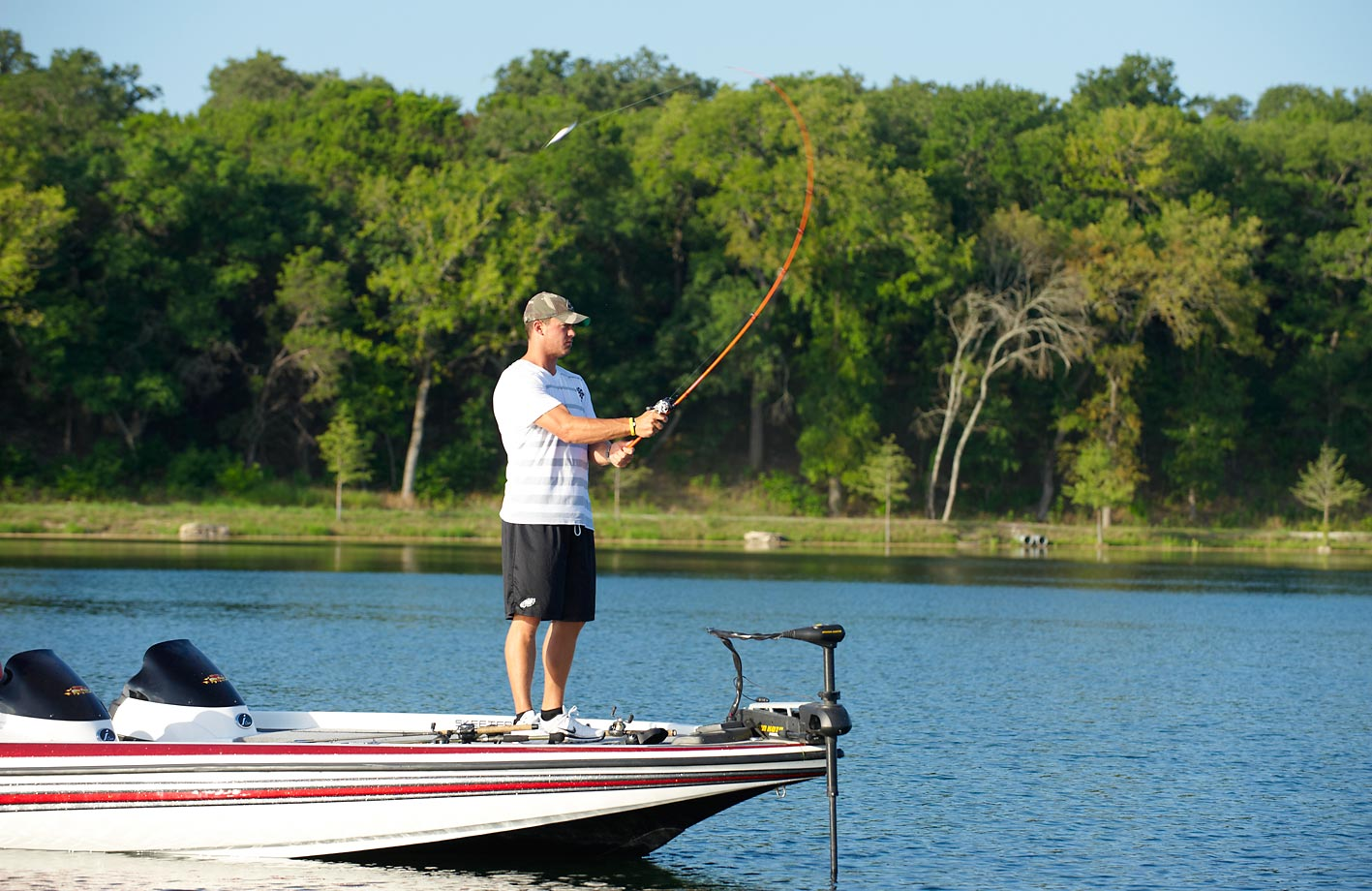 The then-Eagles quarterback fishes for bass in Lake Granbury in Granbury, Texas, in the 2010 off-season.