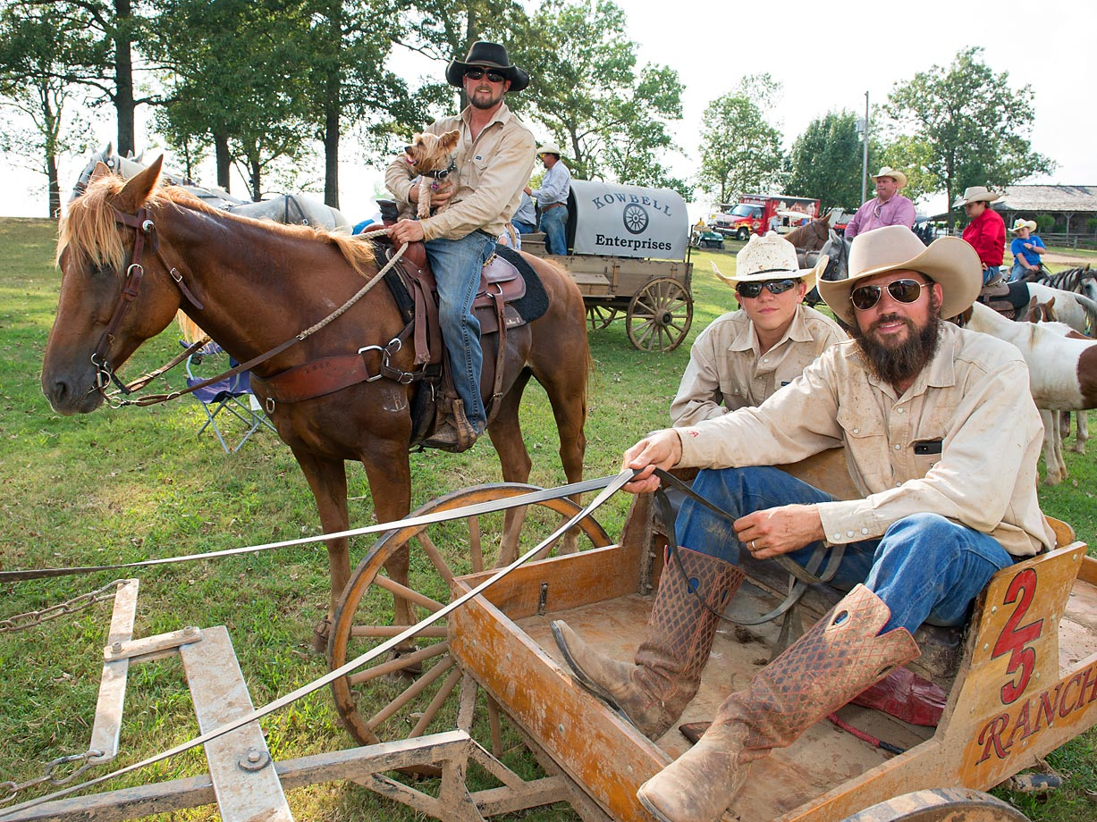 "First time Buckboard Champions team ""2 5 Ranch"" after winning the buckboard championship. (near) Driver Adam Jones and cook Jared Desalvo sit beside outrider Derrick Barger. The Championship was decided in a run-off because there needs to be more than one second difference between the first and second place times."