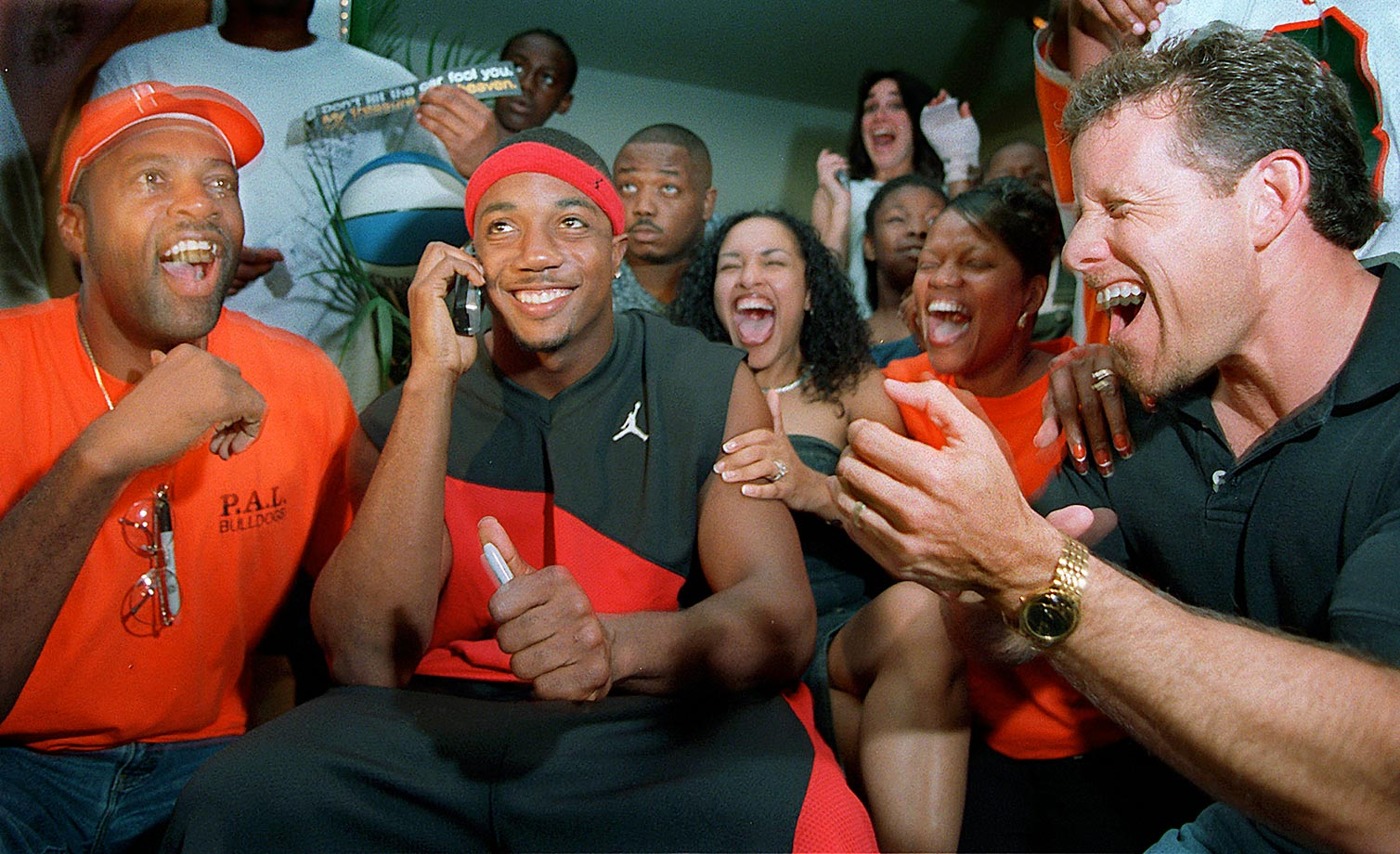 Miami cornerback Mike Rumph gets the call from the San Francisco 49ers that he was selected 27th in the 2002 draft.