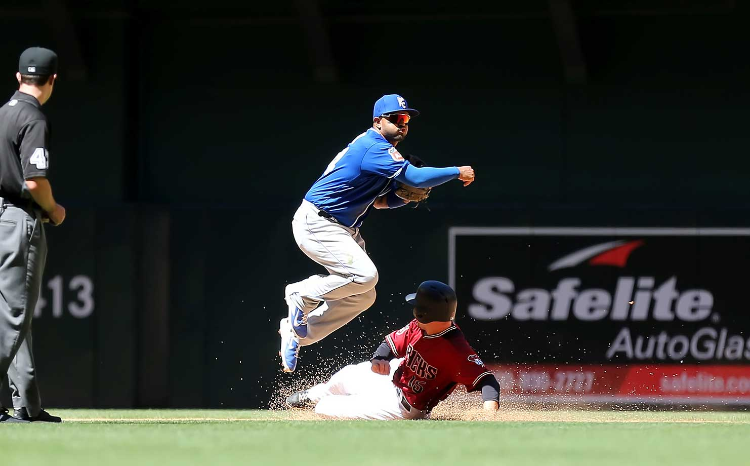 Royals second baseman Christian Colon completes a double play after forcing out Phil Gosselin of Arizona.