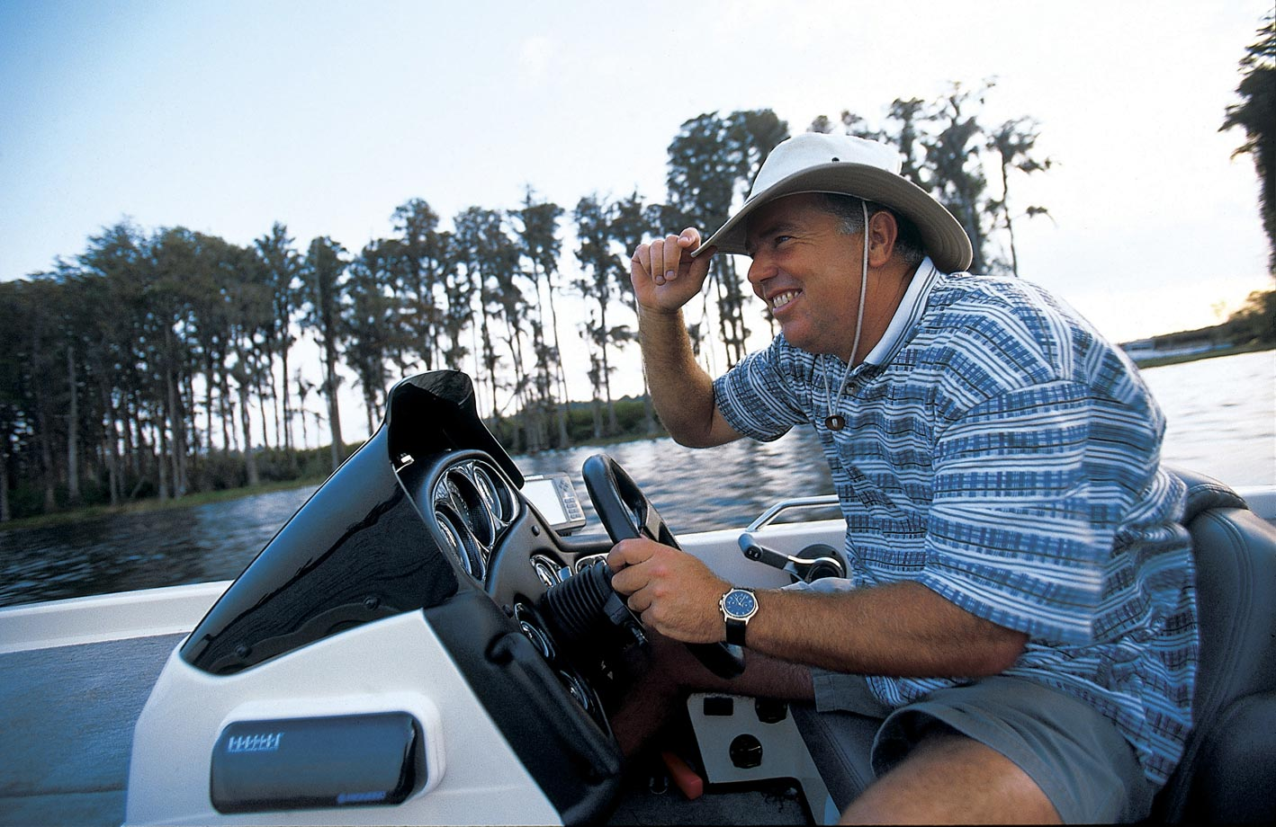 The golfer drives his boat near Orlando in 1998, the best year of his PGA career.
