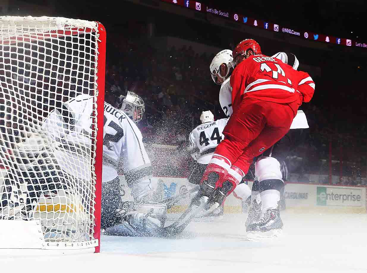 Hurricane rising: Carolina's Nathan Gerbe kicks up a cloud of crystals in front of Kings goalie Jonathan Quick during their game at PNC Arena in Raleigh on November 2, 2014.