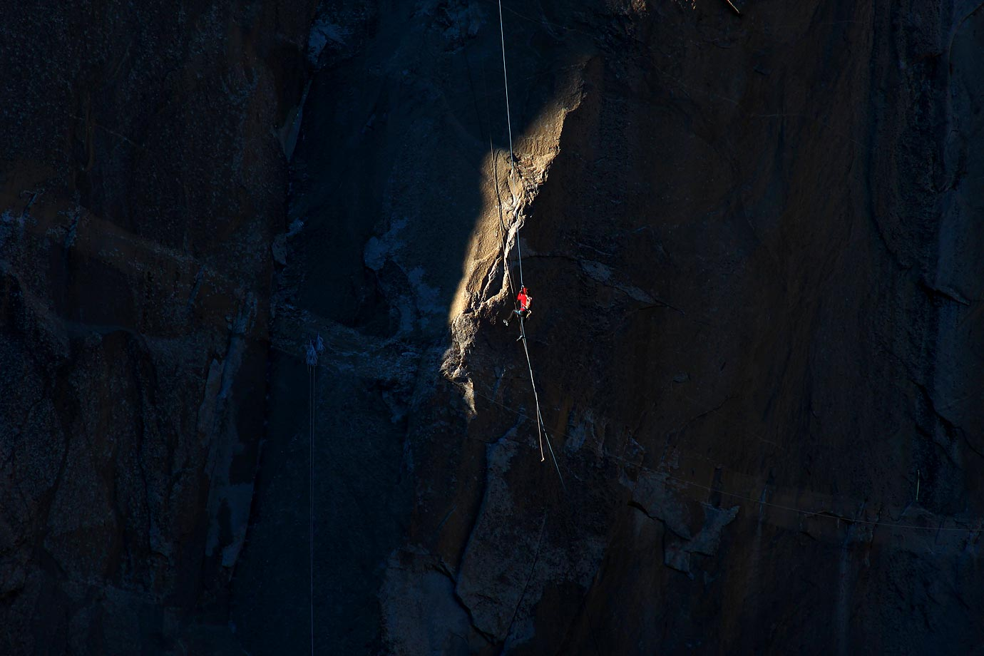 Kevin Jorgeson (in red) ascending the rope to Pitch 17.