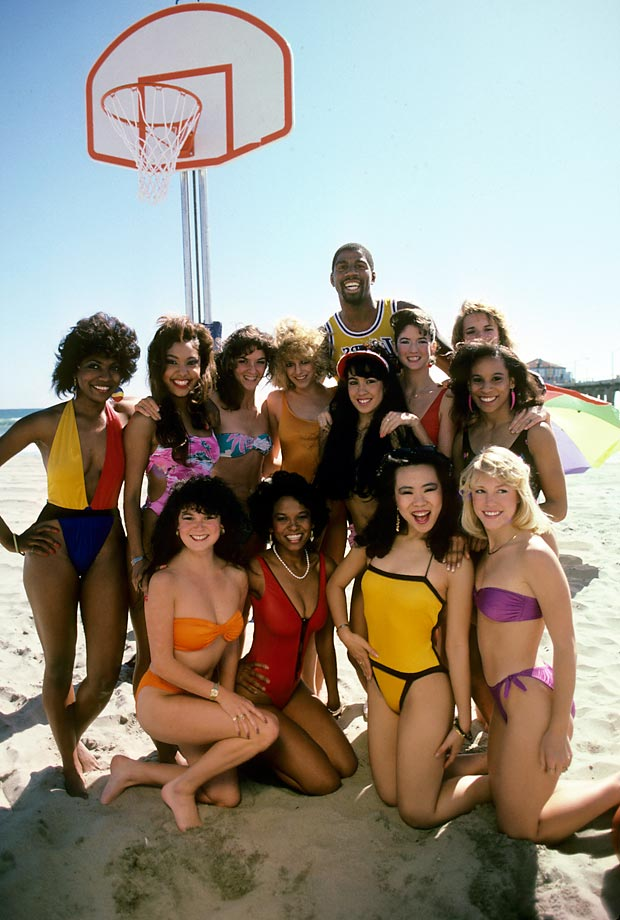 Ervin Johnson shows off his magic in front of 12 adoring women during a 1985 photo shoot in Manhattan Beach.