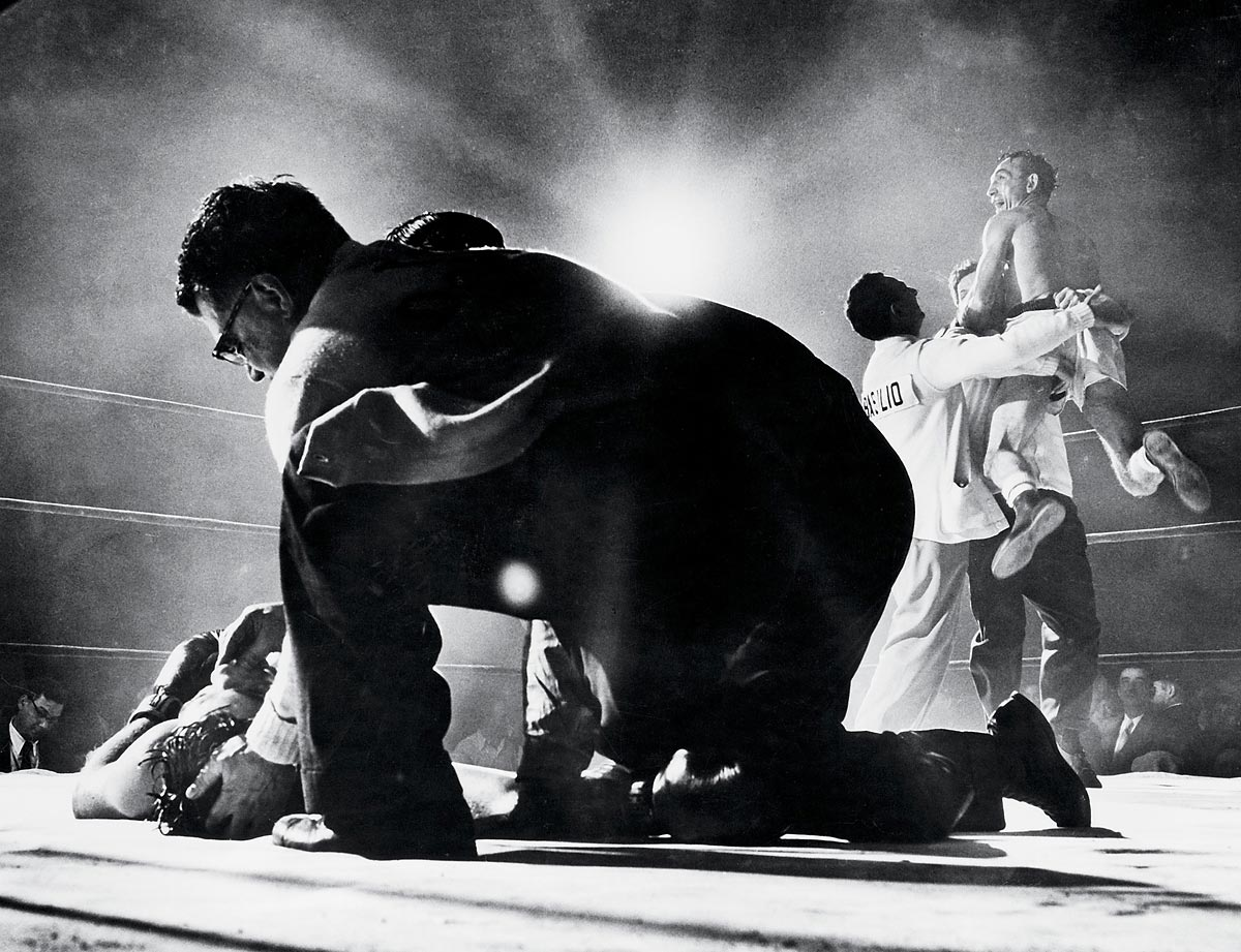 Nov. 30, 1955 | Carmen Basilio (right) celebrates with his cornermen after knocking out Tony DeMarco (left) in the 12th round for the world welterweight title.