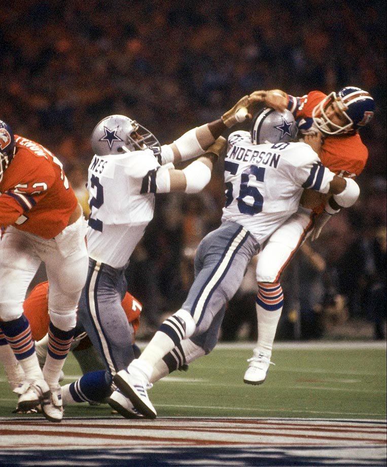 Dallas Cowboys linebacker Thomas Henderson drives Denver Broncos quarterback Norris Weese to the turf. The Cowboys defense ruled the day in New Orleans, forcing eight turnovers and allowing just eight pass completions as Dallas defeated Denver 27-10.