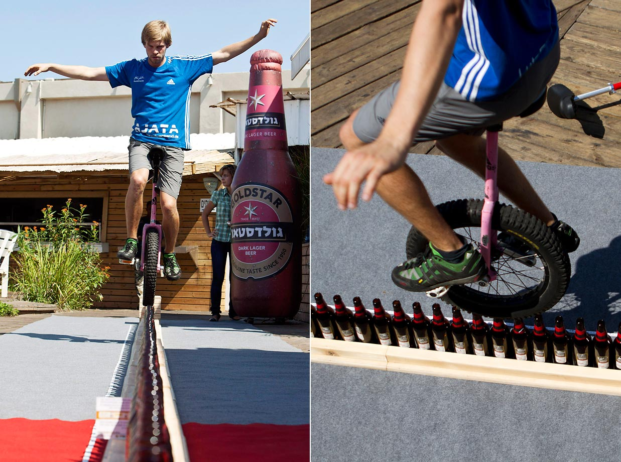 Lutz Eichholz of Germany rode his unicycle a distance of 8.93 meters. He rode over 127 beer bottles.
