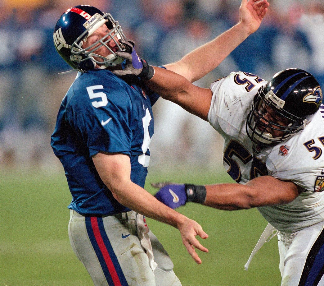 Baltimore Ravens linebacker Jamie Sharper grabs the facemask of New York Giants quarterback Kerry Collins in the fourth quarter. The Ravens defense badgered the Giants all game, recording four sacks and forcing five turnovers to pace a 34-7 victory.