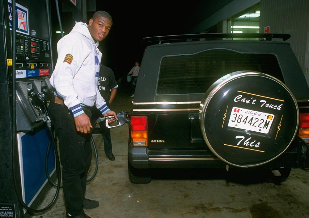 Boxer Riddick Bowe filling his car with gas. The former heavyweight lost just one fight and had 33 knockouts over his career.