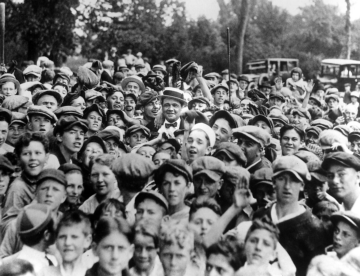 1926 | New York Yankees outfielder Babe Ruth, the Great Bambino, spends time with some fans. The 1926 season was one of Ruth's best as he hit .372 with 47 home runs and 146 RBI.