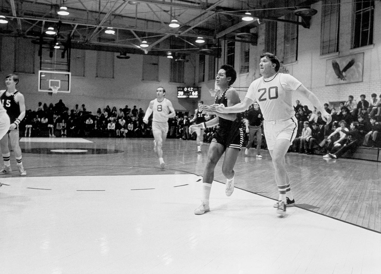 Looking slightly more docile in his formative years, a young and dare-we-say athletic George Steinbrenner guns for a loose ball at a Culver Military Academy alumni basketball game.
