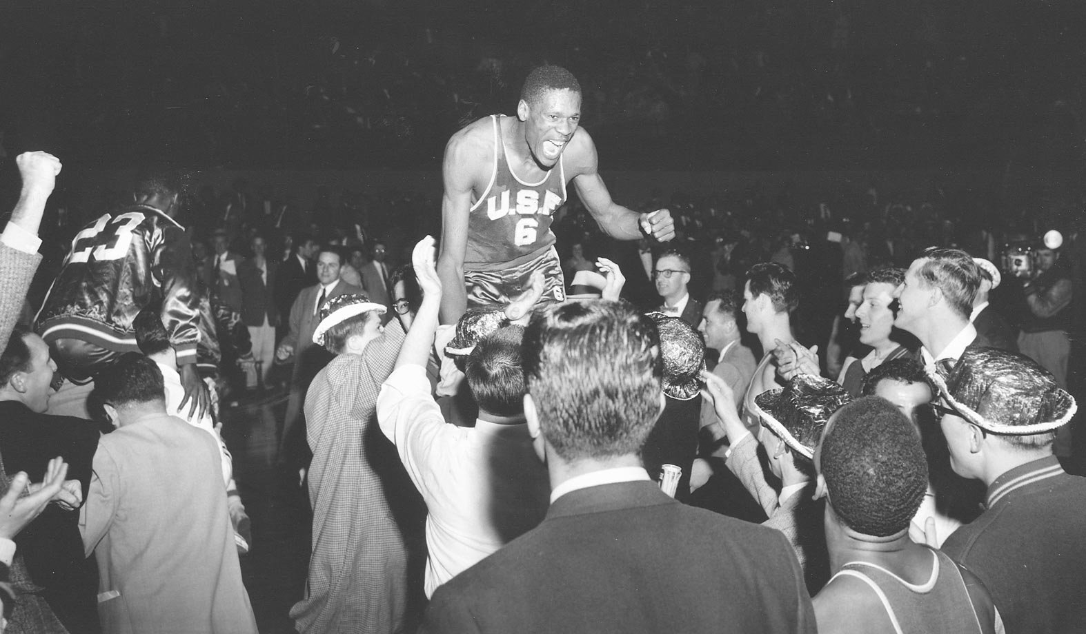 San Francisco's Bill Russell gets a ride off the court after defeating La Salle, 77-63, to win the title in Kansas City. Russell was named most outstanding player after scoring 47 points.