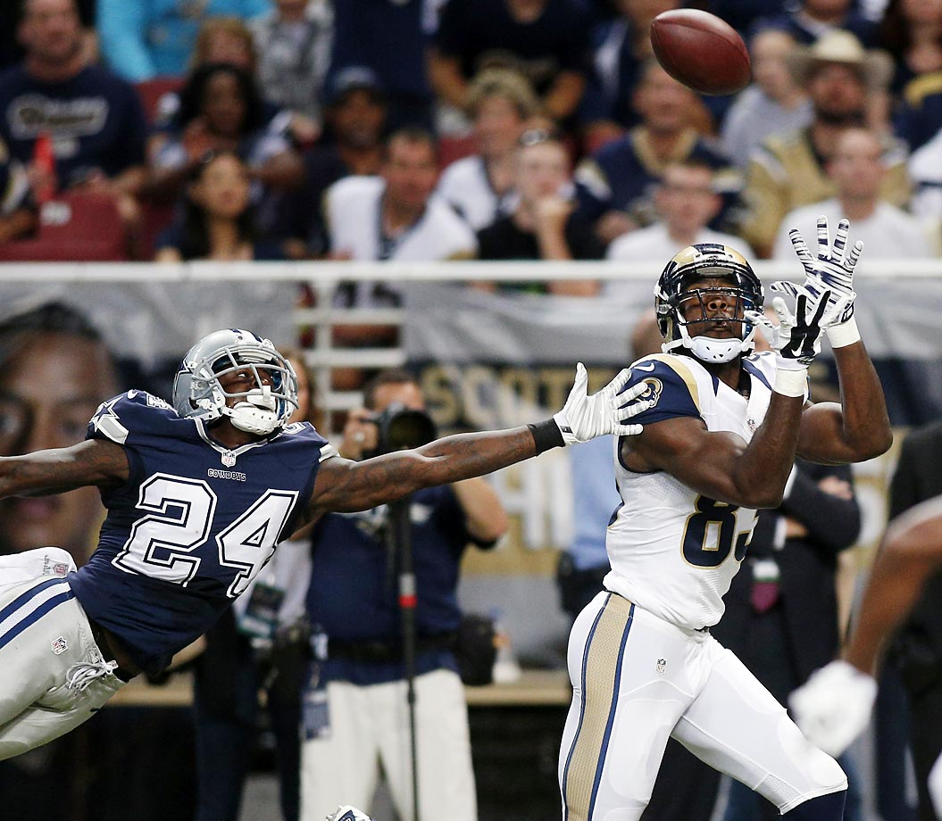Rams wide receiver Brian Quick catches a 51-yard pass for a touchdown as Cowboys cornerback Morris Claiborne defends.