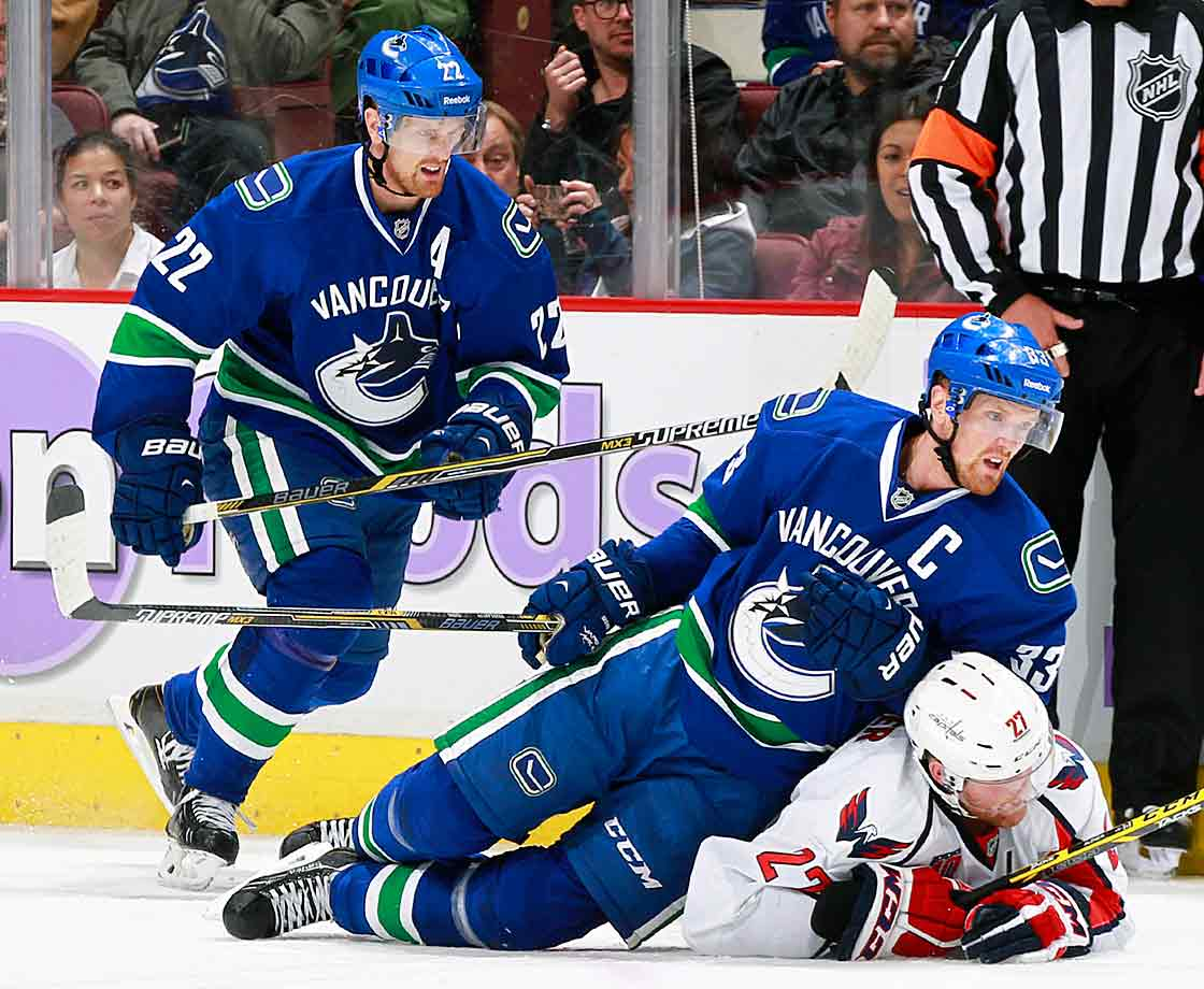 The Canucks' rejuvenated Sedin Twins have been making their presence felt, as Capitals defenseman Karl Alzner learned during a game at Rogers Arena in Vancouver on October 26, 2014.