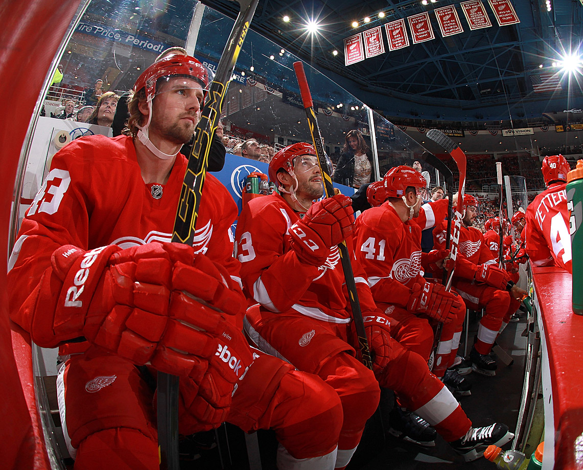 Darren Helm (43) and Pavel Datsyuk (13) watch the action at Joe Louis Arena in Detroit on Halloween. The game proved to be a horror show for the visiting Kings, who were soundly beaten, 5-2.