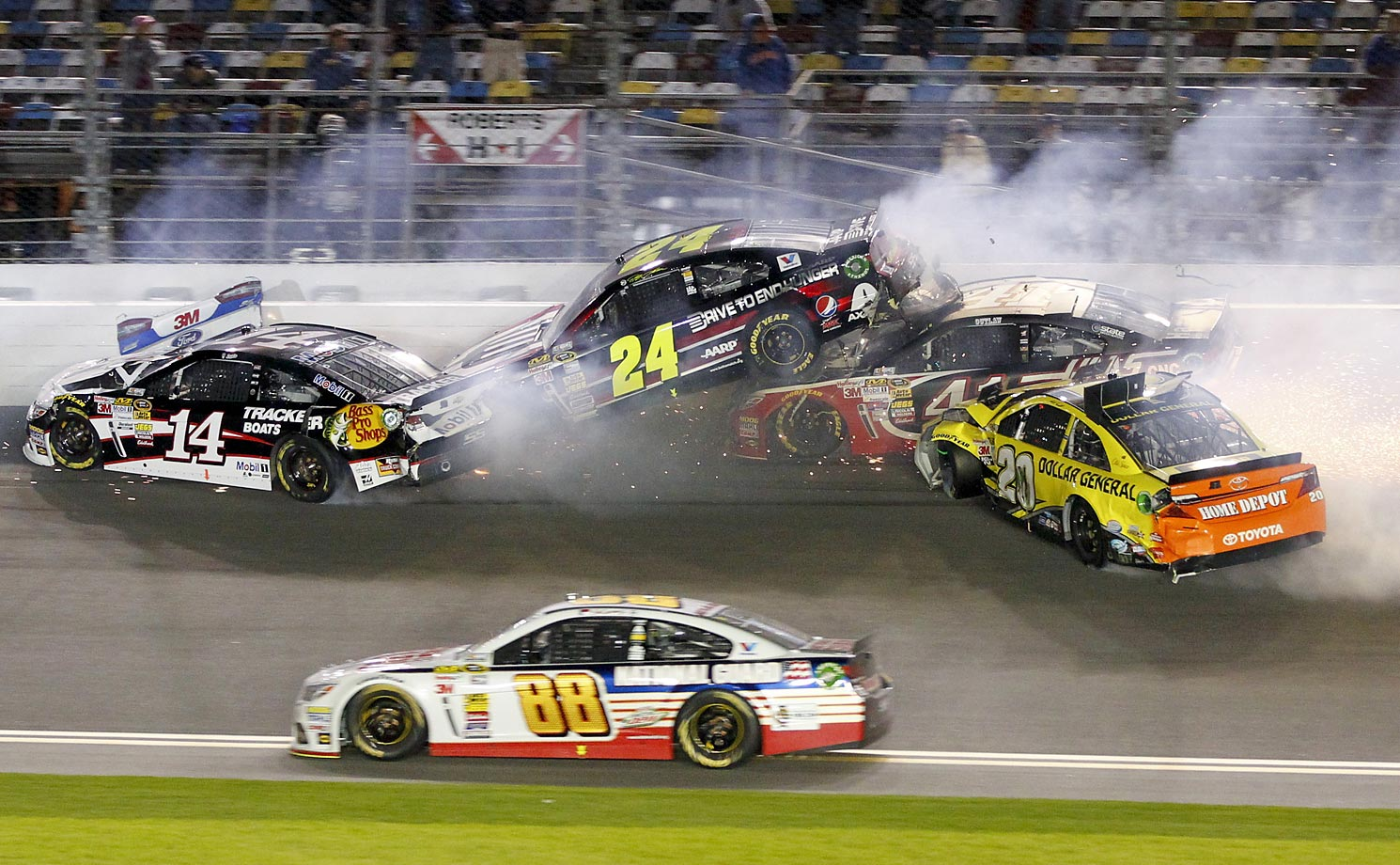 Tony Stewart, Jeff Gordon, Kurt Busch, and Matt Kenseth wreck on the front stretch as Dale Earnhardt Jr. goes low to avoid the crash during the NASCAR Sprint Unlimited auto race at Daytona International Speedway in Daytona Beach, Fla.