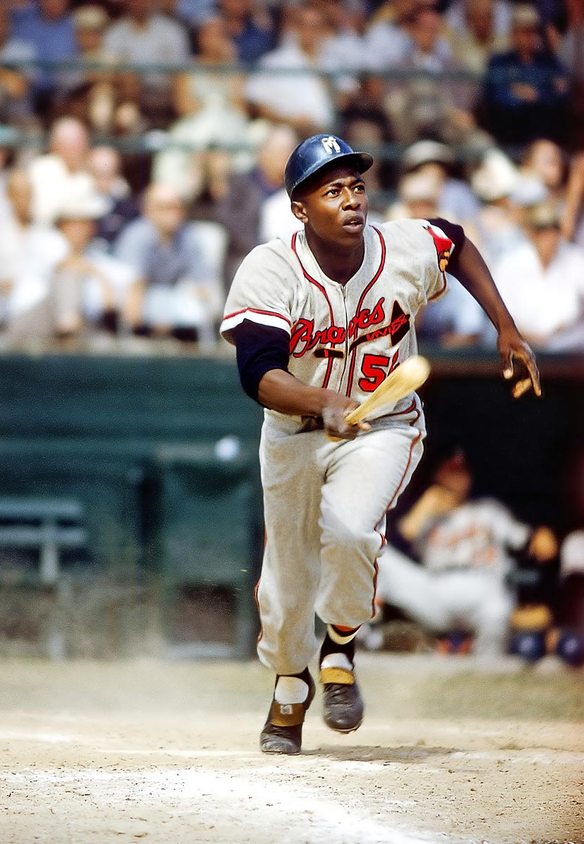 Spring Training, March 30, 1957 | Braves outfielder Hank Aaron starts to run toward first during a spring training game in 1957. That season, Aaron's fourth in the majors, he won the only MVP award in his Hall of Fame career, and he led the league in home runs for the first time, with 44.
