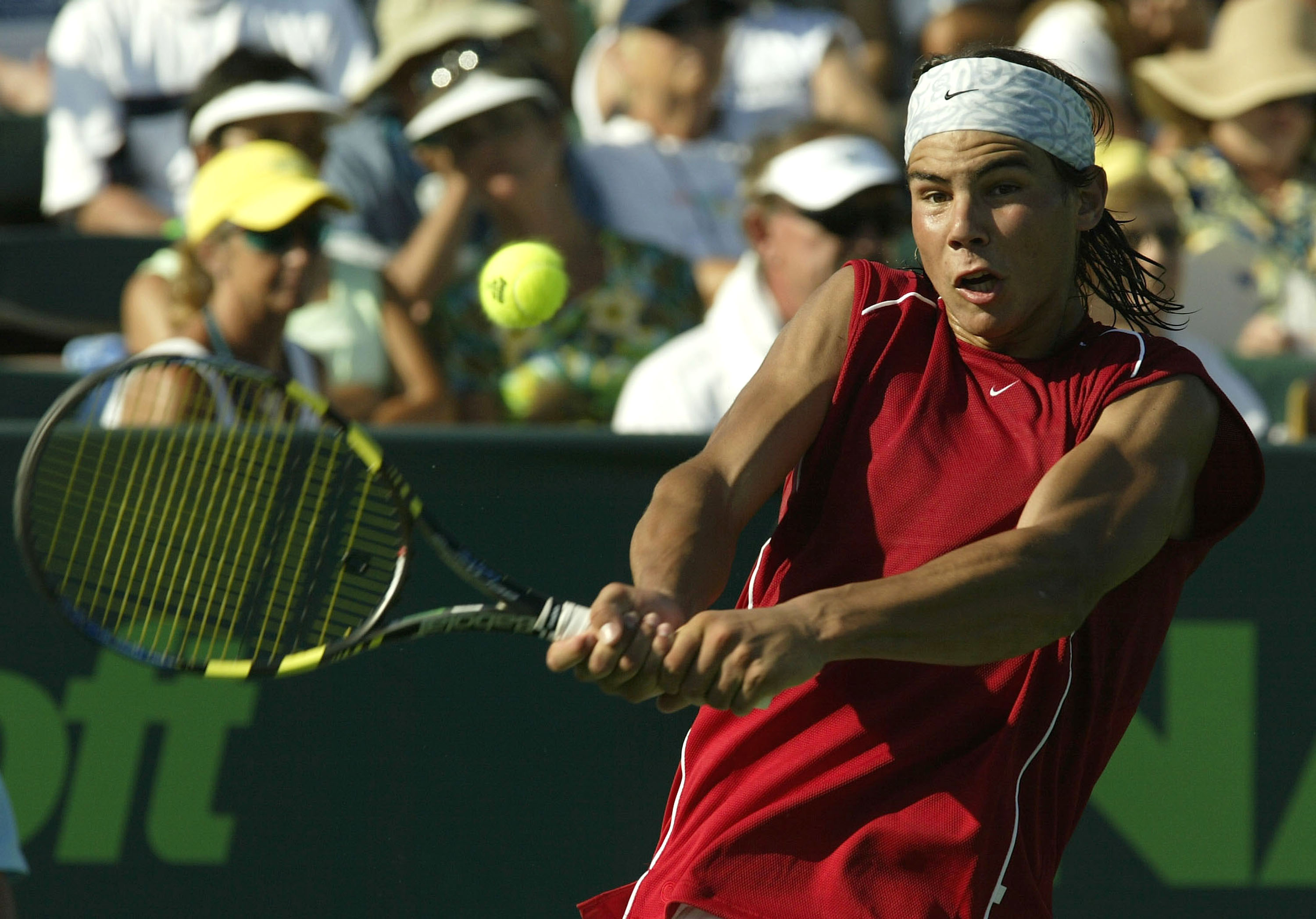 Still sticking with the white headband, Nadal finally opts for a better-fitting top.