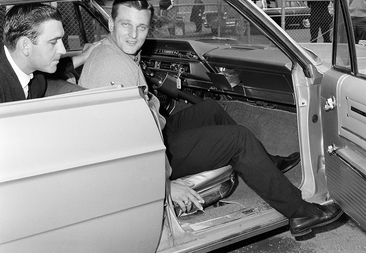 Roger Maris sitting in his car after he injured his leg making a tough catch against the Kansas City Athletics on April 28, 1965.