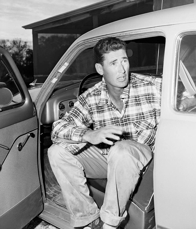 Boston Red Sox star Ted Williams in the driver's seat before he left Perry's Fishing Lodge in Rock Harbor, Fla., in 1952.