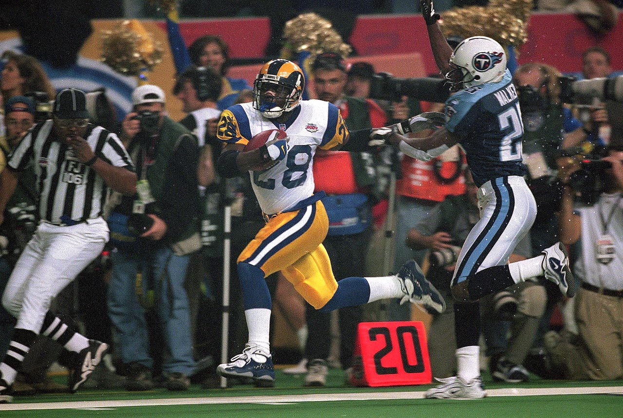 Marshall Faulk races down the right sideline after catching a pass from Kurt Warner. The Tennessee Titans held the St. Louis Rams running back to 17 rushing yards, but Faulk gained 90 yards through the air on five receptions as the Rams won 23-16.