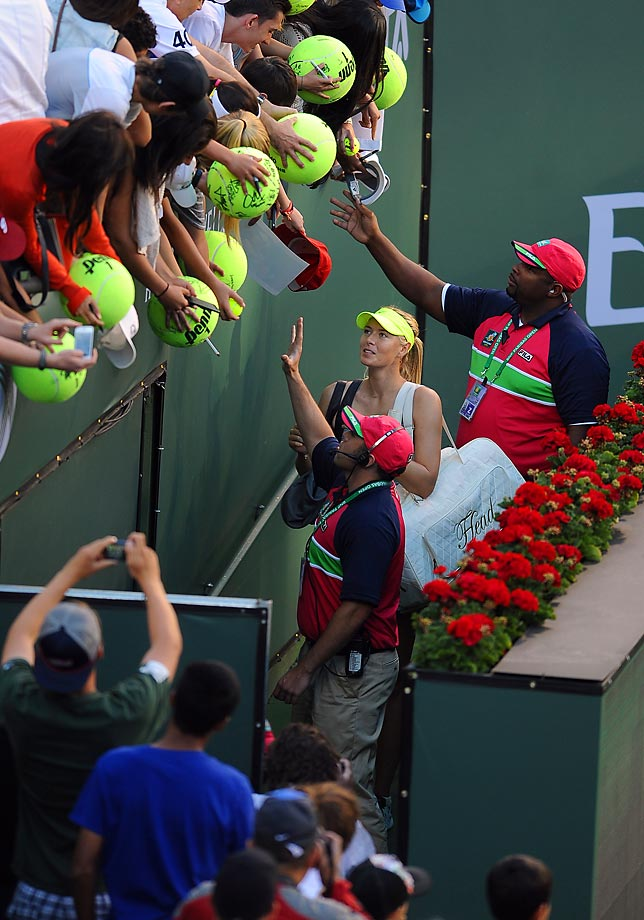 Sharapova sign autographs at the BNP Paribas Open, which she won to solidify her No. 3 standing in the world rankings.