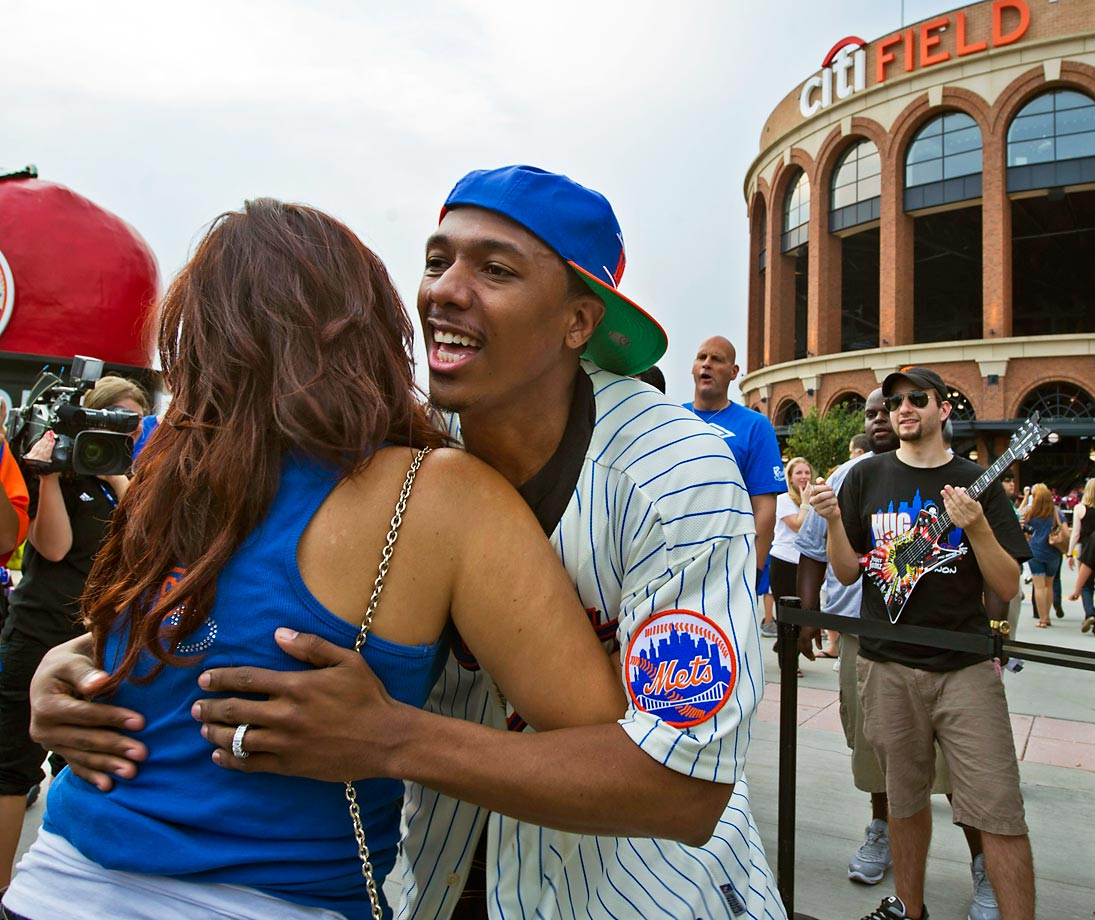 Nick Cannon sets the record for most hugs in an hour outside of the New York Mets' CitiField by hugging over 1,800 people to raise money for the Mets Care Room at New York Hospital in Queens.