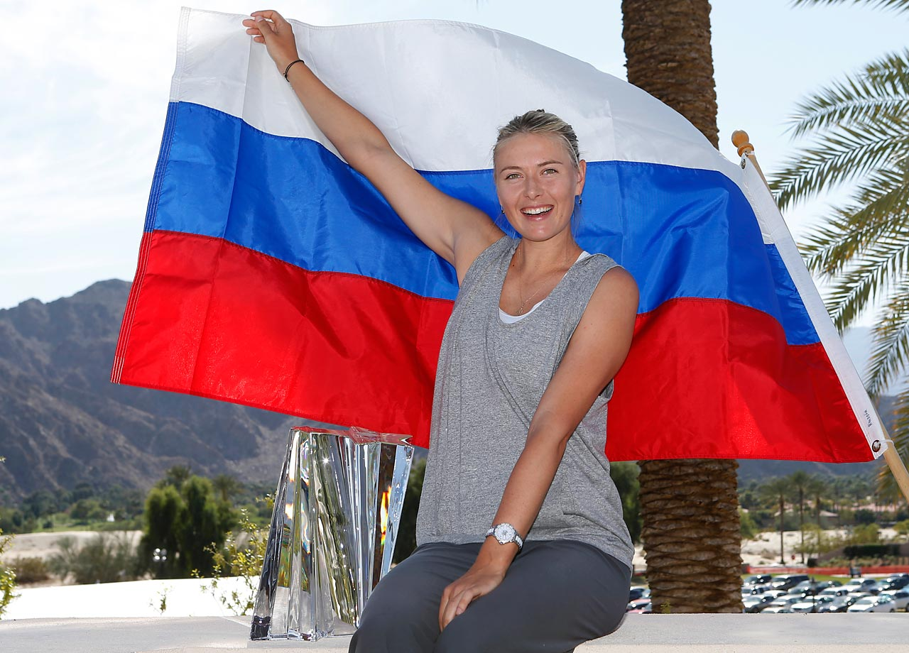 Sharapova poses with the winners trophy after defeating Caroline Wozniacki of Denmark during the singles final of the BNP Paribas Open.